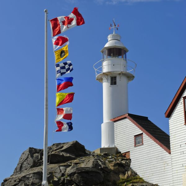 Nautical flags and lighthouse